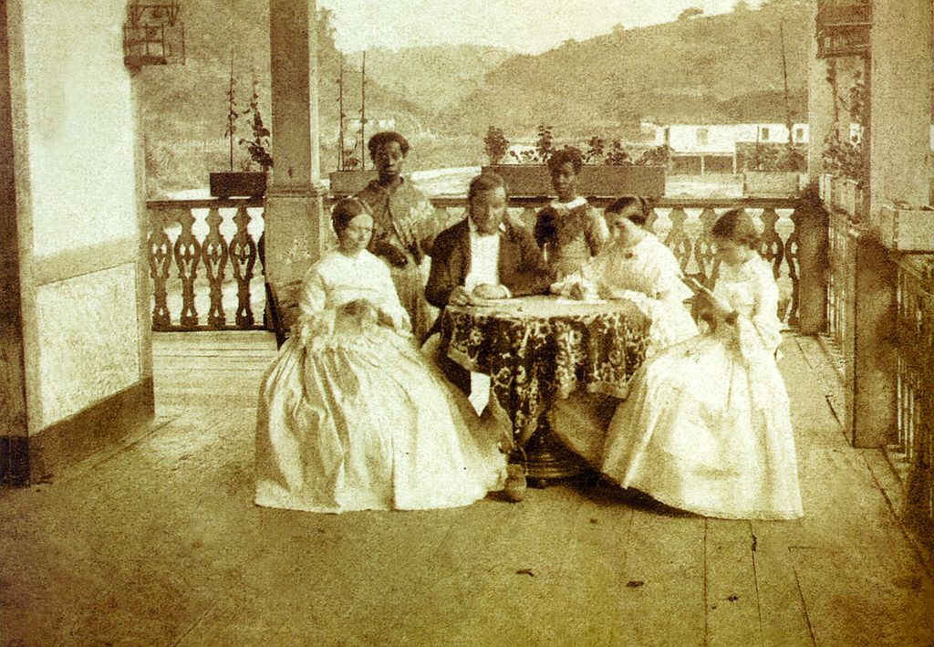 Brazilian family with house slaves, late 19th century