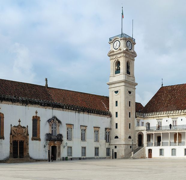 The tower of the University of Coimbra, Portugal. At left, the Manueline door to the Chapel of Saint Michael