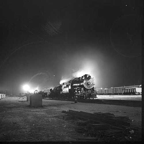 Barstow, California. A view of the Atchison, Topeka and Santa Fe Railroad yard at night  Photo: Jack Delano