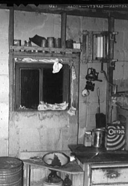 Kitchen window stuffed with towels and clothing in dust storm area. Williams County, North Dakota - Russell Lee
