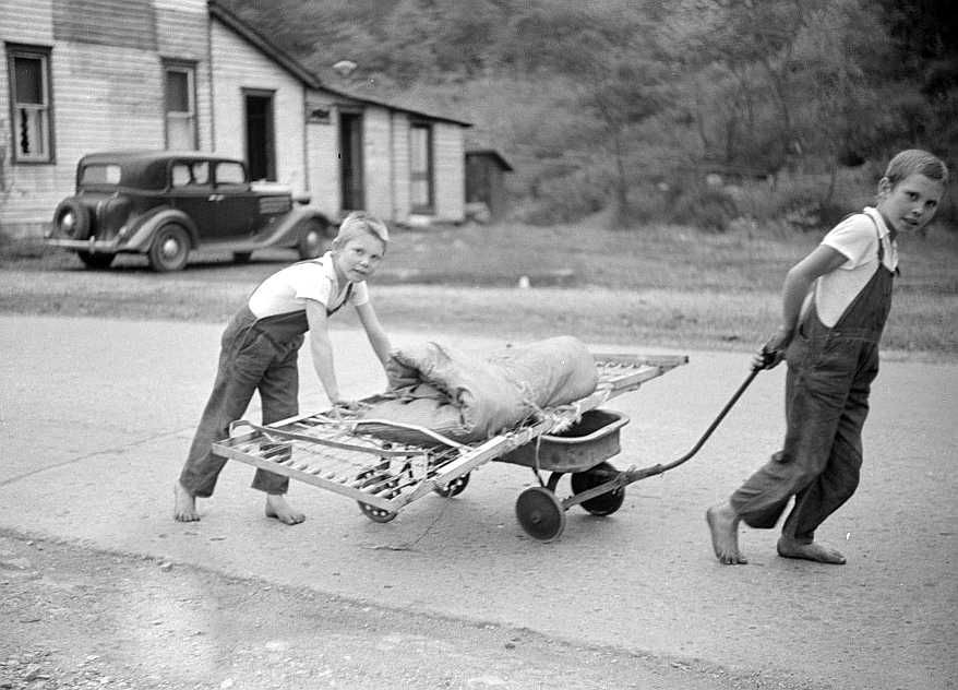 Children taking home remains of a bed. Coal mining camp, Scotts Run, West Virginia Photo: Marion Post Wolcott