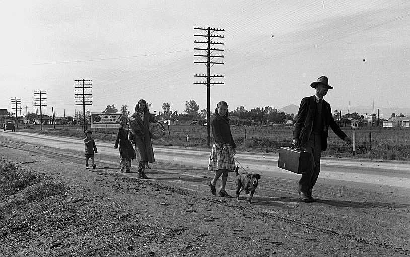 On U.S. 99. Near Brawley, Imperial County. Homeless family of seven  Photo: Dorothea Lange