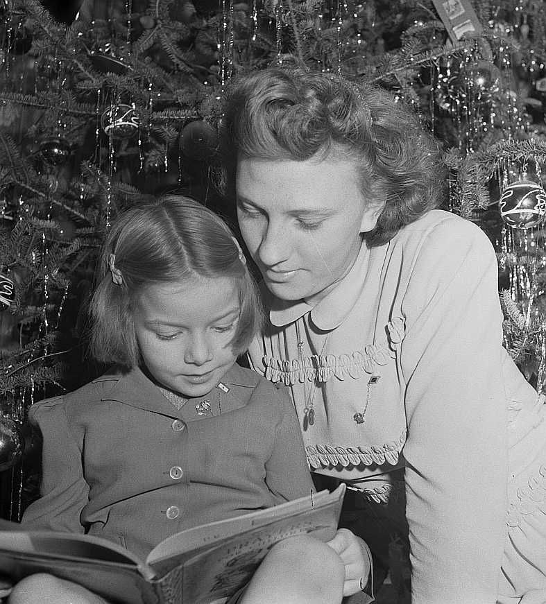 Child and her aunt at the Christmas tree, New York  Photo: Marjory Collins