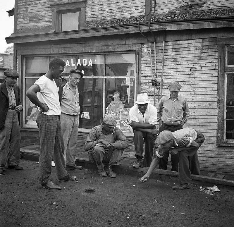Miners shooting craps in front of company store. Osage, West Virginia   Photo: Marion Post Wolcott