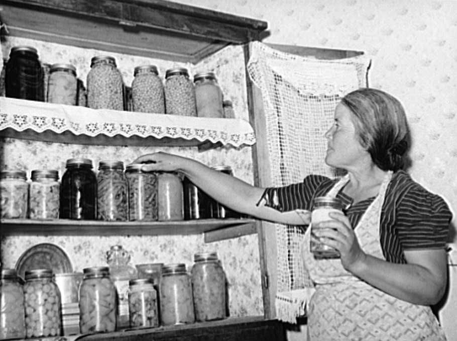 Farmer's wife with canned fruit and vegetables, Camisal, New Mexico Photo: Russell Lee
