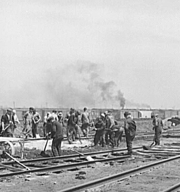 Gandy-dancer crew working in Bensenville yard of the Chicago, Milwaukee, Saint Paul and Pacific Railroad   Photo: Jack Delano