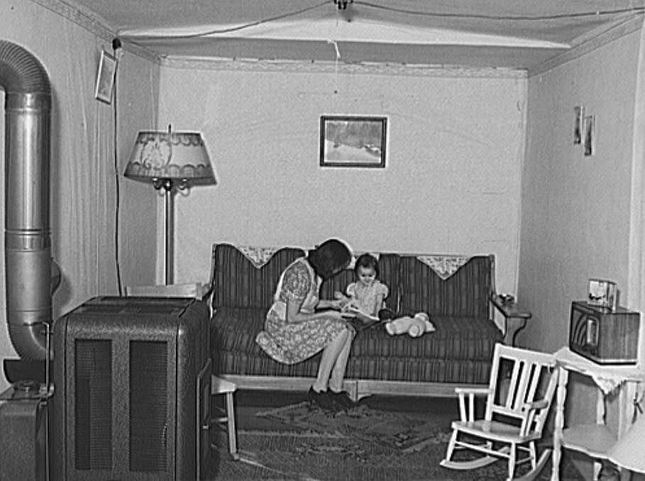 Interior of living room of married couple living in remodeled boxcar. Earl Fruit Company ranch. Kern County, California Photo: Russell Lee