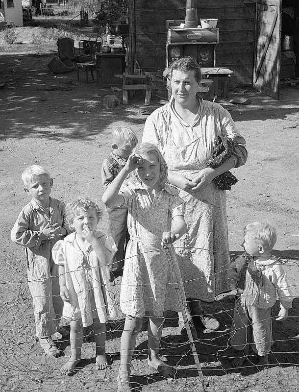 Family living in shacktown community, Yakima, Washington Photo: Dorothea Lange