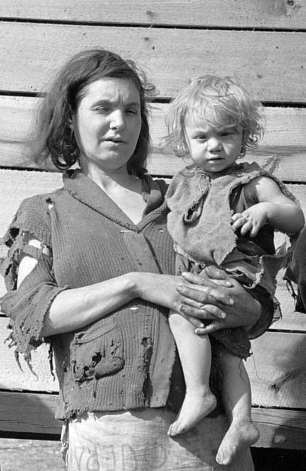 Mother and baby of family of nine living in field on U.S. Route 70 in Tennessee, near Tennessee River  Photo: Csrl Mydans