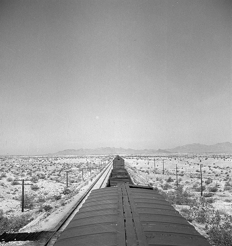 The Atchison, Topeka, and Santa Fe Railroad train between Needles and Barstow, California cuts west across the Mojave Desert  Photo: Jack Delano