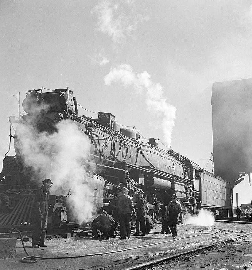 Checking a locomotive as it leaves the roundhouse in the Atchison, Topeka and Santa Fe Railroad. Clovis, New Mexico Photo: Jack Delano