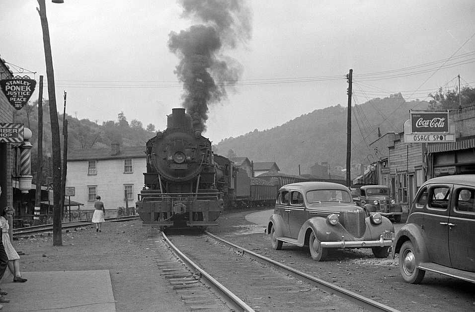 Train pulling coal through center of town morning and evening, Osage, West Virginia   Photo: Marion Post Wolcott