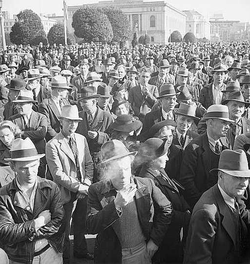 Listening to speeches at mass meeting of Works Progress Administration   Photo: Dorothea Lange