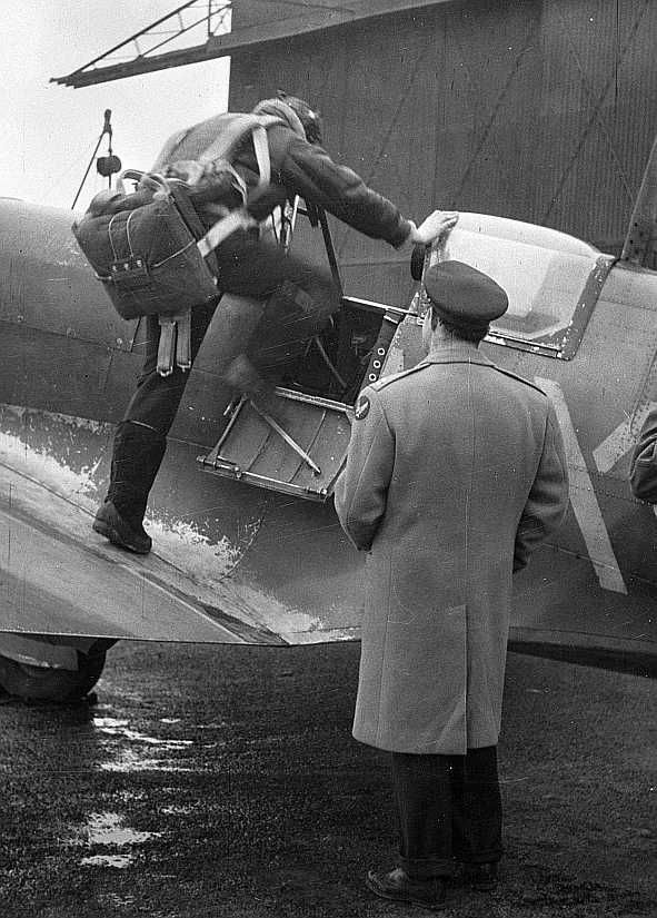 Lieutenant E.S. Schofield, of Belleville, Ohio and Lieutenant R.F. Sargent of Youngstown, Ohio, pictured in Britain, as the former prepares to pilot a Spitfire plane.