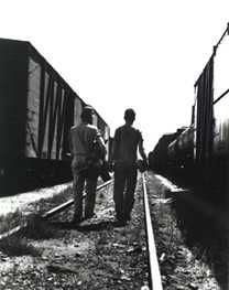 Seeking a boxcar to ride Depression era railroad yard from Library of Congress collection